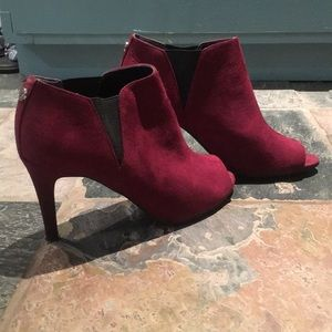 Maroon and black Unisa heels.